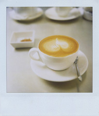 drinking coffee can heal headache? (i'm Jac) Tags: film coffee analog polaroid sx70 drink polaroidsx70 1on1photooftheweek 1on1photooftheweekjune2008