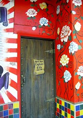 Captian Ed's Next Door (See El Photo) Tags: door flowers roses 15fav color colour petals colorful colore entrance doorway numbers tiles thorns farbe couleur scroll entry nextdoor 1f faved  captaineds   7013 paintedflowers   seventhousandandthirteen