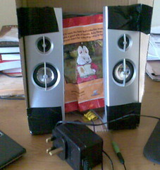 Speakers duct taped into cardboard box