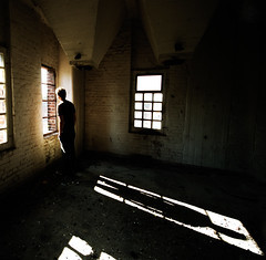 The Young Man Who Stared Through A Broken Window (rasenkantenstein) Tags: light shadow portrait urban man art abandoned window standing self germany dark room atmosphere magdeburg brewery urbex rasenkantenstein