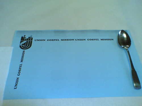 An Union Gospel Mission placemat set with a spoon