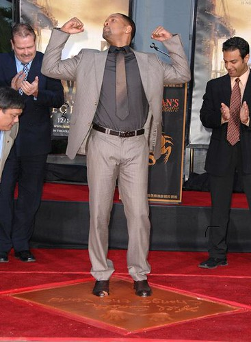 Pictures of Will Smith  at Grauman's Chinese Theatre getting his foot and handprints
