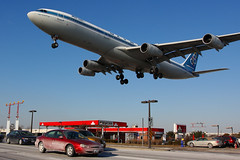 Olympic A340 (Tom Podolec) Tags: toronto ontario canada cars station plane canon airplane four airport crossing aircraft engine aeroplane gas international airline airbus olympia 23 300 olympic dslr airlines mississauga runway petro fuel pearson petrocanada yyz roadway a340300 airportroad a340313x torontopearsoninternationalairport allrightsreserved airportrd sxdfa 40d cyyz news46 canon40d 200801311454380727 thisimagemaynotbeusedinanywaywithoutpriorpermission 20062008 airportroadspotting