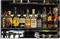 And what's your poison . . . (grantthai) Tags: bar whiskey swing shelf alcohol whisky redlabel jackdaniels blacklabel johnnywalker wildturkey jameson jimbeam canadianclub ballantines greenlabel chivasregal goldlabel grantthai grantcameron