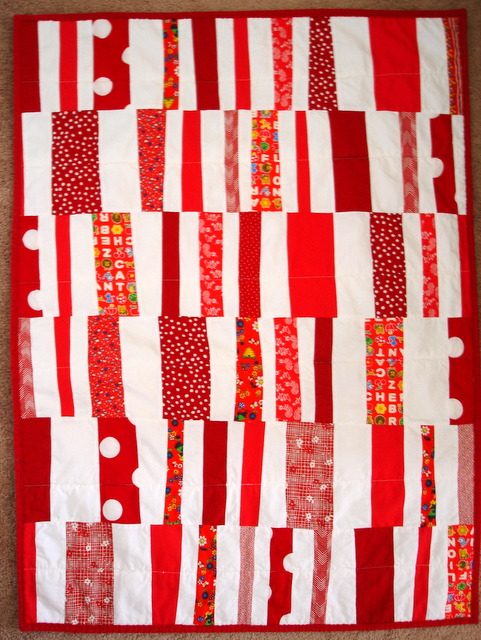red and white Hop Skip and a Jump baby quilt