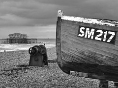 SM217 (Douguerreotype) Tags: uk england bw beach monochrome mono pier boat seaside fishing brighton britain westpier gb seafront derelict eastsussex uploaded:by=flickrmobile flickriosapp:filter=nofilter