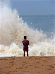 Washing your troubles away (Midhun Manmadhan) Tags: sea india man beach waves alone wave kerala thoughts mind solitary canons3is
