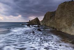 Cabo de Gata (elosoenpersona) Tags: sunset sea costa atardecer coast mar spain cabo nikon mediterranean mediterraneo waves d70 andalucia gata olas almeria cabodegata blueribbonwinner nijar 10faves abigfave elosoenpersona