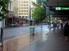 Queen St, Auckland (*(hugh)*) Tags: newzealand urban buildings reflections pavement auckland storefronts queenst roddandgunn hughwinters nationalbankcashpoint