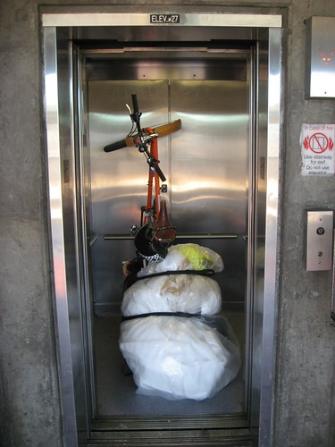 Xtracycle carrying foam in BART elevator