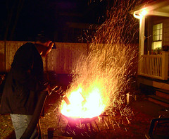 This is how you start a fire (Shawn Toohey) Tags: light red party usa hot get wet beer hat yellow night drunk america fence out beard ma fun outdoors fire fan back spring insane crazy amazing dangerous funny flickr ketchup bright baseball top massachusetts vacuum dry blow hose grill josh plastic flame cups passed cap porch stupid ten inferno mustard hazzard intoxicated springfield how railing mad mass grilling pyro sparks ideas mode mightygirl pyromaniac exhaust vac pyromania raging windbreaker the spfld stupidest mightygirlcom mightygirlnet