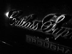 cutlass (dmixo6) Tags: urban classic cars sign night vancouver logo words code rust symbol text wheels rusty communication number chrome transportation font letter alphabet weirdass dmixo6