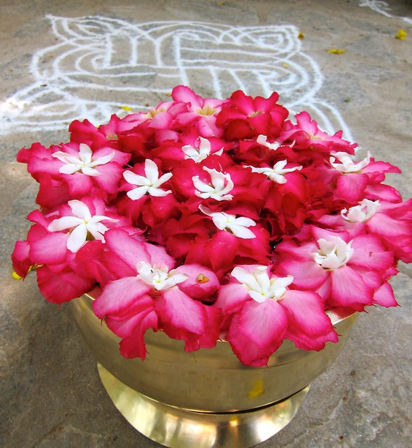 A Kolam And Flowers Found In Front Of A Home