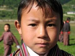 School boy (Linda DV) Tags: street travel school portrait people cute face barn children geotagged kid child bhutan candid young kind criana himalaya enfant nio 2007 dziecko bambino    travelphotography lapsi copil dijete  dt  bumthangvalley travelportrait   lindadevolder