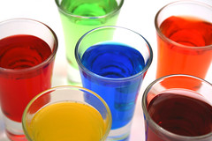 Spots (moggsterb) Tags: blue red orange green yellow canon purple shots drinks alcohol vodka colored coloured shotglasses shooters 400d aplusphoto flavouredvodka artlegacy