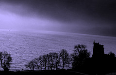 Urquhart Castle, Loch Ness (sanjibm) Tags: mist lake castle water monochrome monster landscape scotland blackwhite ruins day britain outdoor bank eerie shore romantic loch lochness inverness ness nessie urquhart drumnadrochit