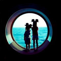 cruise graduates (-Angela) Tags: cruise vacation silhouette magic siblings disney frombehind porthole mykids 2008 disneycruise