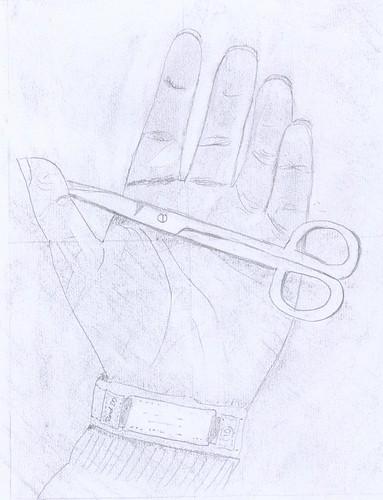 scissors and hand