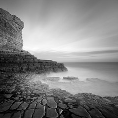 Monknash Headland (Adam Clutterbuck) Tags: ocean uk longexposure greatbritain sea blackandwhite bw seascape heritage monochrome wales square point landscape mono coast blackwhite rocks unitedkingdom britain pavement stones cliffs bn shore elements glamorgan gb limestone blogged bandw sq oe headland greengage monknash adamclutterbuck sqbw bwsq showinrecentset walglamheri openedition