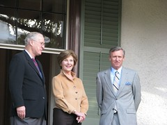 Mr. Moe, Mrs. Bush, and Dr. Milligan on the veranda at President Lincoln's Cottage.