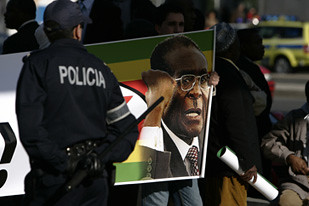 "Poster supporting President Mugabe of Zimbabwe outside the EU-Africa Summit in Lisbon on December 9, 2007. Mugabe blasted the ""gang of four"" European leaders for being agents of British imperialism. by Pan-African News Wire File Photos"