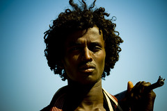 Afar warrior in Assayta, Danakil, Ethiopia (Eric Lafforgue) Tags: africa travel portrait people haircut men beauty face horizontal hair photography gun day african culture tradition ethiopia ethnic hairstyle adultsonly oneperson tribo ak47 frontview hornofafrica individuality ethnology afar eastafrica thiopien etiopia ethiopie realpeople etiopa colorimage lookingatcamera onlymen onemanonly  danakil etiopija 1people pastoralist ethiopi  etiopien etipia kalachnikov  etiyopya  nomadicpeople 2024years   mg1656 asaita  assayta