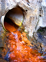 Tainted Water (The Joy Of The Mundane) Tags: orange water rock flow rocks pipe drain sewage pollution minerals mineral tainted flowing waste sewer pour pouring drainage taint polluted runoff wastewater