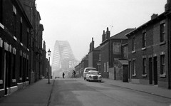 Up the Mersey, 1970. (Fray Bentos) Tags: bridge lancashire gaslight widnes rivermersey terracedhouses runcornbridge