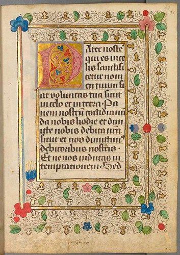 Colourful lettrine, text and incomplete border of leaves and decoration