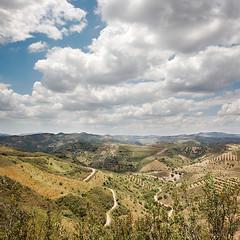 (Sr. Cordeiro) Tags: sky portugal clouds canon landscape hills paths roads algarve cloudshadows 40d ilustrarportugal