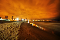 Light Pollution and Cloud Drifts Over North Avenue Beach (Explored!) (Seth Oliver Photographic Art) Tags: chicago clouds buildings reflections iso200 illinois nikon midwest waves nightimages nightlights skyscrapers wind lakes cityscapes lakemichigan lakeshoredrive nightshots beautifulclouds pinoy cookcounty nightscapes urbanscapes lightpollution secondcity goldcoast northavenuebeach windycity chicagoist d90 nightexposures 10secondexposure wetreflections cityofbigshoulders longexpsoures aperturef90 clouddrifts manualmodeexposure setholiver1 nocturneimages 1024mmtamronuwalens ballheadtripodmountedshot timedelaytriggeredshot placestoseeandvisitinchicago sethoneofyourbest