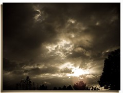 The World Through Gods Eyes (D2 Photography) Tags: life sunset sun storm nature sepia clouds bravo earth storms thesun planetearth magicdonkey wowiekazowie