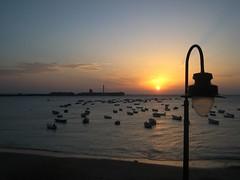 SuNSeT (RoOoOo!!!) Tags: ocean sunset sea sky sun castle sol beach water clouds atardecer mar agua farola barcos playa andalucia cielo nubes cadiz barcas castillo caleta
