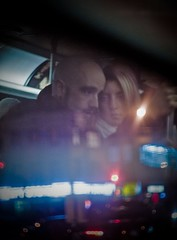 Night Seeking (Airchinapilot) Tags: street woman reflection bus window glass night standing canon 50mm couple candid blonde translink 30d coastmountain smctakumar50mmf14