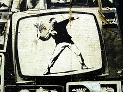Molotov Flower Bomber (See El Photo) Tags: street flowers 15fav streetart art television 510fav wow poster tv post wheatpaste paste ripped banksy posted pasted 100views toss masked 3f throw 4f 1f faved 5f 6f 2f 7f 111v1f 8f nowgone