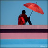 Man with red umbrella
