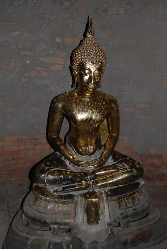 Bronze Buddha statue inside the main chedi (Wat Yai Chai Mongkol) by Adrian Lazar