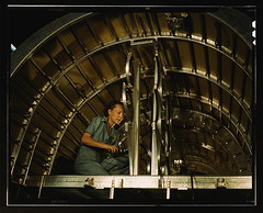 Installing oxygen flask racks above the flight deck of a C-87 transport at the Consolidated Aircraft Corporation plant, Fort Worth, Texas  (LOC)