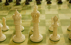 A close up on the white king of a chess board.