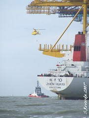 Lowering some device (sjoerd_reverda) Tags: rotterdam ship zhen beached hua tugs