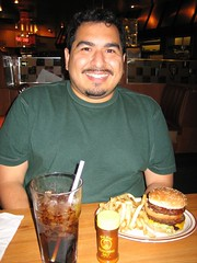 James before digging into his original double deck hamburger. (09/14/2005)