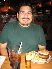 James before digging into his original double deck hamburger. (09/14/2005)