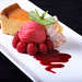 meyer lemon tart with red berry sorbet and lemon madelines
