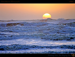 Sinking Into The Raging Sea (tomraven) Tags: ocean sunset sea newzealand sky sun storm reflections geotagged interestingness surf framed gale explore frontpage 2009 raging explored otakibeach inexplore geo:lat=40749403 tomraven seawardwhitegleamingthrothebusyscud geo:lon=175107179 q209