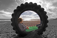 Tyred (GI Les) Tags: winter bw tractor storm color colour beach girl aftermath looking view angle wide tire pebbles devon observe vista warren portal tyre westcountry 2014 dawlish
