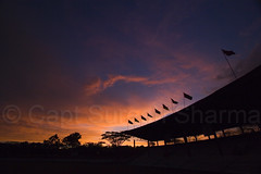 Bombay Stadium, NDA.at Dusk (Captain Suresh Sharma) Tags: sunset sky india crimson silhouette clouds training army evening asia colours dusk stadium shed flags maharashtra shelter venue pune nda flutter indianarmy blueribbonwinner abigfave nationaldefenseacademy flutteringflags kharagwasla