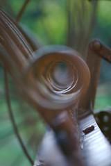 spring forward (lecates) Tags: wheel metal spring nikon rust antique farm equipment bolt blade plough d80 105mmf28gvrmicro