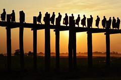 Buddhist monks crossing the U Bein bridge during sunset - Amarapura - Myanmar (PascalBo) Tags: bridge sunset people sun silhouette yellow jaune outdoors soleil nikon asia southeastasia d70 burma religion monk buddhism pont myanmar asie coucherdesoleil bouddhisme amarapura ubein birmanie moine 123faves asiedusudest lpday pascalboegli lpsilhouettes