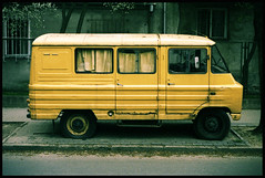 (rybokula) Tags: auto life street old city portrait film colors car yellow 35mm cross central poland slide warsaw oldtimer portret analogphotography warszawa sensia mokotw samochd canon50e ulica uk crossproces mokotoff rybokula 100push400