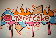 The logo of Planet Cake on the wall (joyceandjessie) Tags: cakeclass